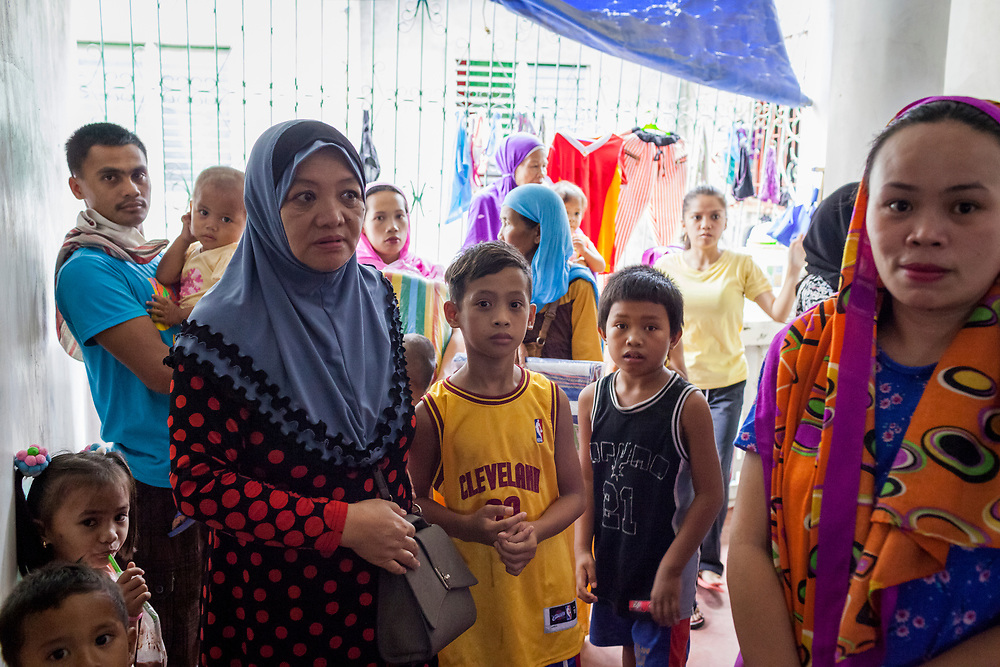 Davao City, Mindanao, Philippines - JUNE 22: Marawi evacuees are seen inside a house at the Mini Forest Barangay 23C. Over 40 people reside in this house after fleeing the ongoing conflict in Marawi after the ISIS backed Maute Group has sieged the city. Currently, over 570 families and roughly 2500 evacuees from Marawi reside in the Mini Forest.