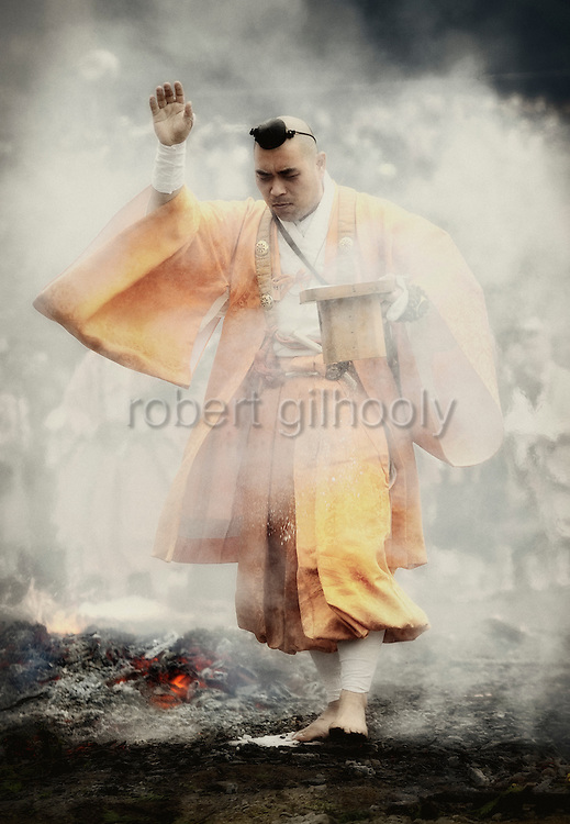 Ascetic Buddhist monks take part in a purification ceremony in which they walk across burning embers in Takao, west of Tokyo, Japan on Sunday 09 March  2009.