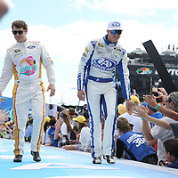 Race car drivers Landon Cassill (L) and Trevor Bayne are seen during driver introductions prior to the 58th Annual NASCAR Daytona 500 auto race at Daytona International Speedway on Sunday, February 21, 2016 in Daytona Beach, Florida.  (Alex Menendez via AP)