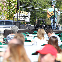 Musician Tatum Shappley performs for the lunch crowd at Friday's Chilifest in downtown Tupelo.