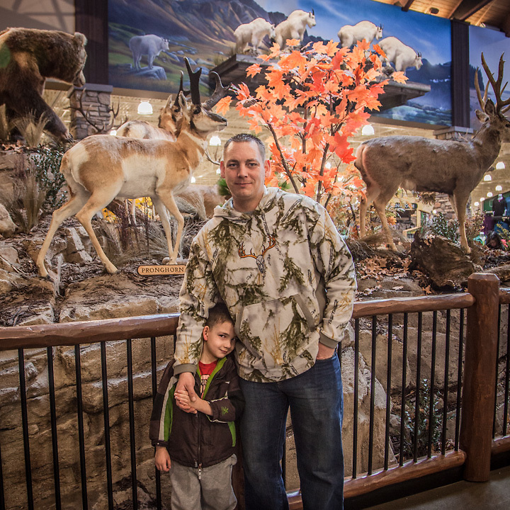 "Air Force fireman Brian Patterson and his four year old son, Justin, on the day of Cabelas retail store opening in South Anchorage.  ""I'm from Montana…this is Heaven!""  ginabrian07@gmail.com"