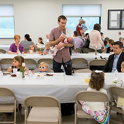 30 APRIL 2016 -- WENTZVILLE, Mo. -- &quot;Gianna Baby Families&quot; from across the St. Louis area gather for a reception following a Mass at St. Gianna Catholic Church in Wentzville, Mo, Saturday, April 30, 2016 recognizing the visit of Gianna Emanuela Molla, daughter of St. Gianna Beretta Molla, on the the 10th anniversary of the parish.<br /> <br /> Photo by Sid Hastings.