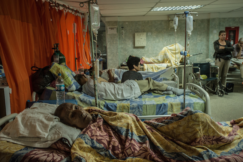 MERIDA, VENEZUELA - JANUARY 29, 2016: Patients rest in the hallways at the overcrowded public hospital in Merida,  where news reports said there had been no running water for days to wash the operating rooms. PHOTO: Meridith Kohut for The New York Times