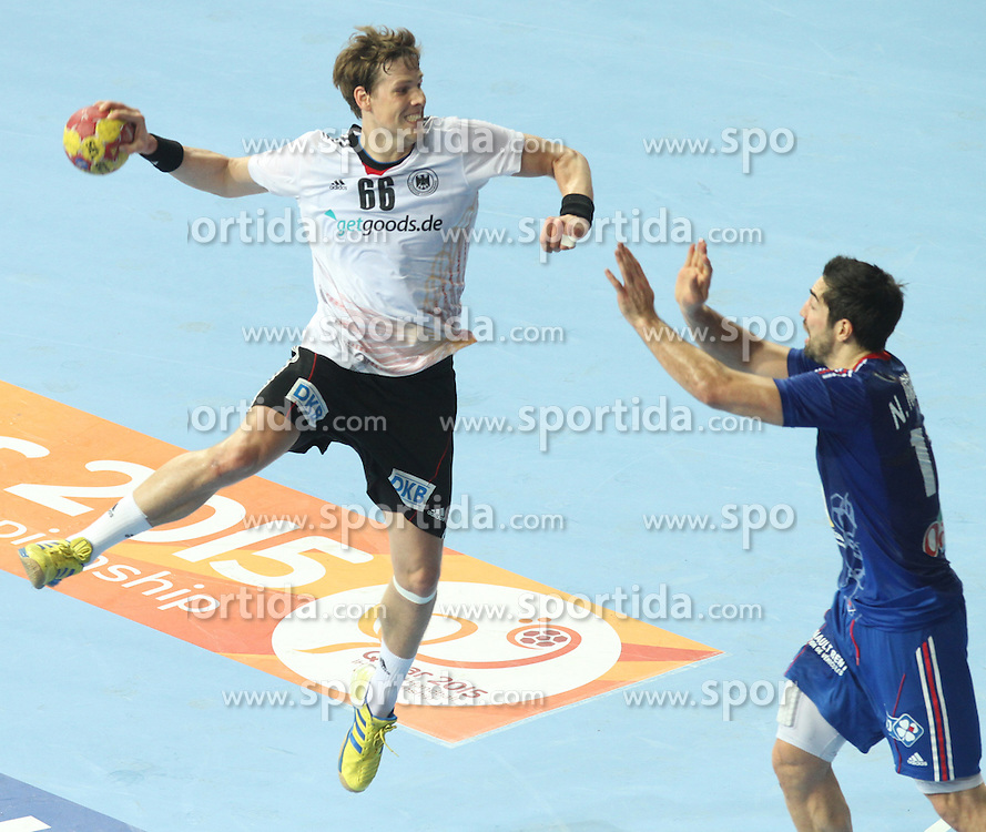 18.01.2013 Barcelona, Spain. IHF men's world championship, prelimanary round. Picture show Sven-Sören Christophersen  in action during game between France vs Germany at Palau St Jordi / Sportida Photo Agency