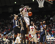 """Ole Miss' Reginald Buckner (23) vs.East Tennessee State's Kinard Gadsden-Gilliard (35) and East Tennessee State's Hunter Harris (20) at the C.M. """"Tad"""" Smith Coliseum in Oxford, Miss. on Saturday, December 14, 2012. Mississippi won 77-55 to improve to 7-1. (AP Photo/Oxford Eagle, Bruce Newman).."""