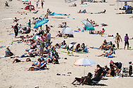 People crowd in Hermosa Beach, California, Thursday June 15, 2017. Temperatures are expected to climb 12 to 18 degrees above normal this weekend through at least the middle of next week, according to the National Weather Service.(Photo by Ringo Chiu)<br /> <br /> Usage Notes: This content is intended for editorial use only. For other uses, additional clearances may be required.