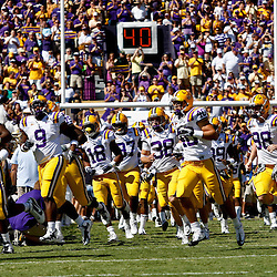 Oct 2, 2010; Baton Rouge, LA, USA; LSU Tigers players run onto the field prior to kickoff of a game between the LSU Tigers and the Tennessee Volunteers at Tiger Stadium.  Mandatory Credit: Derick E. Hingle