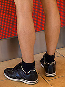 close up of a person's leg standing in front of a counter