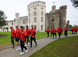 CARDIFF, WALES - Friday, October 7, 2016: Wales players stroll past Hensol Castle during a team walk at the Vale Resort ahead of the 2018 FIFA World Cup Qualifying Group D match against Georgia. Andy King, Chris Gunter, Neil Taylor, James Collins and Sam Vokes. (Pic by David Rawcliffe/Propaganda)