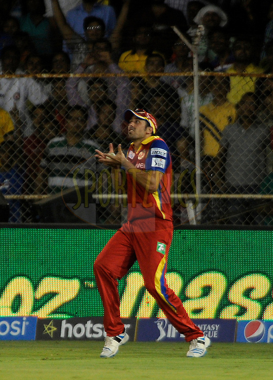 David Wiese of Royal Challengers Bangalore takes a catch to get the wicket of Stuart Binny of Rajasthan Royals during match 22 of the Pepsi IPL 2015 (Indian Premier League) between The Rajasthan Royals and The Royal Challengers Bangalore held at the Sardar Patel Stadium in Ahmedabad , India on the 24th April 2015.<br /> <br /> Photo by:  Pal Pillai / SPORTZPICS / IPL