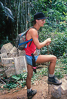 Raleigh International. Leader ready with traps to capture, record then release wildlife. Borneo, Malaysia, SE AsiaBorneo, Malaysia, SE Asia 1994