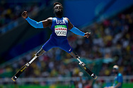 Regas Woods, of the United States, competes in the men's long jump T42 final, during the Paralympic Games, at the Olympic Stadium, in Rio de Janeiro, Brazil, on Sept. 17, 2016. (AP Photo/Mauro Pimentel)