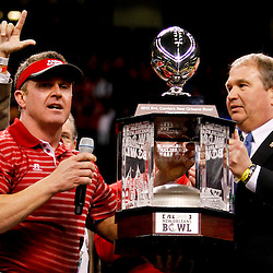 December 22, 2012; New Orleans, LA, USA; Louisiana-Lafayette Ragin Cajuns head coach Mark Hudspeth accepts the New Orleans Bowl trophy following a win over the East Carolina Pirates in the New Orleans Bowl at the Mercedes-Benz Superdome. UL-Lafayette defeated East Carolina 43-34. Mandatory Credit: Derick E. Hingle-USA TODAY Sports