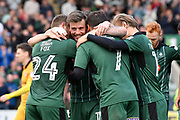 Graham Carey (10) of Plymouth Argyle celebrates scoring a goal to give a 3-0 lead to the home team with Antoni Sarcevic (7) of Plymouth Argyle, David Fox (24) of Plymouth Argyle and Oscar Threlkeld (18) of Plymouth Argyle during the EFL Sky Bet League 2 match between Plymouth Argyle and Newport County at Home Park, Plymouth, England on 17 April 2017. Photo by Graham Hunt.