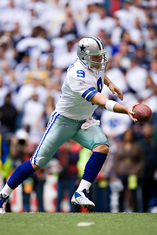 IRVING, TX - JANUARY 13:   Tony Romo #9 of the Dallas Cowboys makes a handoff against the New York Giants during the NFC Divisional playoff at Texas Stadium on January 13, 2008 in Dallas, Texas.  The Giants defeated the Cowboys 21-17.  (Photo by Wesley Hitt/Getty Images) *** Local Caption *** Tony Romo