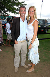 NICK STILEMAN and ALICE FERGUSON sister of Sarah, Duchess of York at the Cartier International polo at Guards Polo Club, Windsor Great Park, on 30th July 2006.<br />