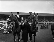 03/08/1960<br /> 08/03/1960<br /> 03 August 1960<br /> R.D.S Horse Show Dublin (Wednesday). Mr. Kevin Boland T.D. Minister for Defence presenting the Hunting Horn Award (presented by the Irish Department of Defence) to Mrs Dawn Wofford on &quot;Hollandia&quot; and Captain W.A. Ringrose on &quot;Loch an Easpaig&quot;, joint first prize-winners of the Epreuve de Puissance International Jumping Competition at the Dublin Horse Show.