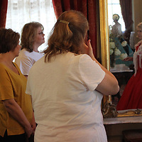 Lois White, right, discusses a parlor in The Magnolias.