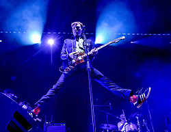 Pictured: Franz Ferdinand lead singer Alex Kapranos took the crowd by storm.<br /> <br /> 60,000 revellers packed into central Edinburgh to bring in the New Year. Franz Ferdinand headlined the concert in the gardens, with a spectacular firework display bringing in 2019.<br /> <br /> © Dave Johnston / EEm