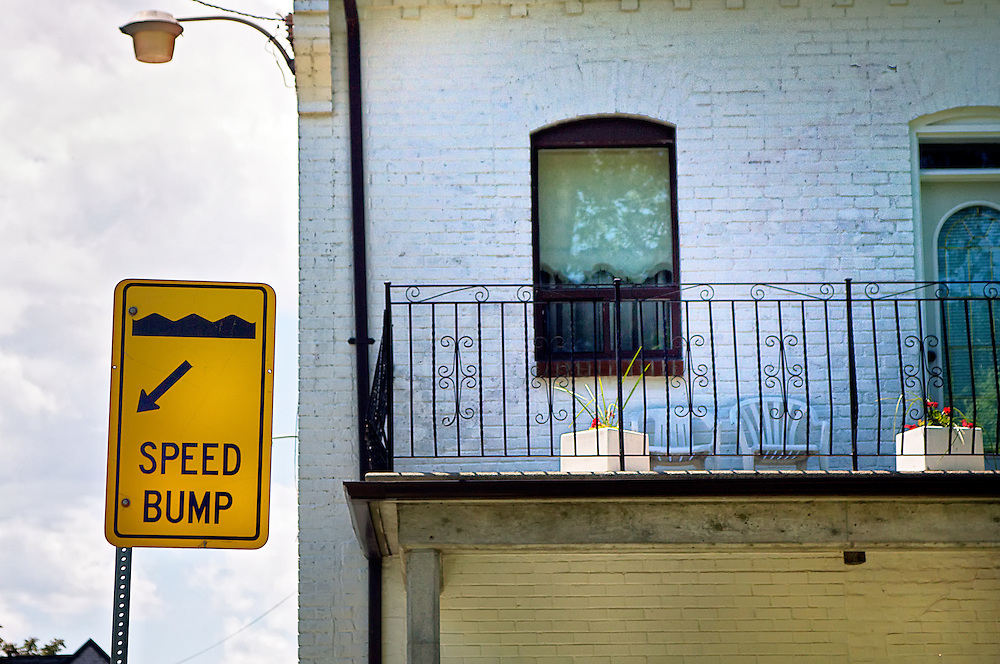Speed Bump Sign Beside House
