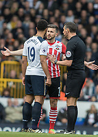 Football - 2016 / 2017 Premier League - Tottenham Hotspur vs. Southampton<br /> <br /> Shane Long of Southampton and Mousa Dembele of Tottenham  speak with the Referee Andre Marriner at White Hart Lane.<br /> <br /> COLORSPORT/DANIEL BEARHAM