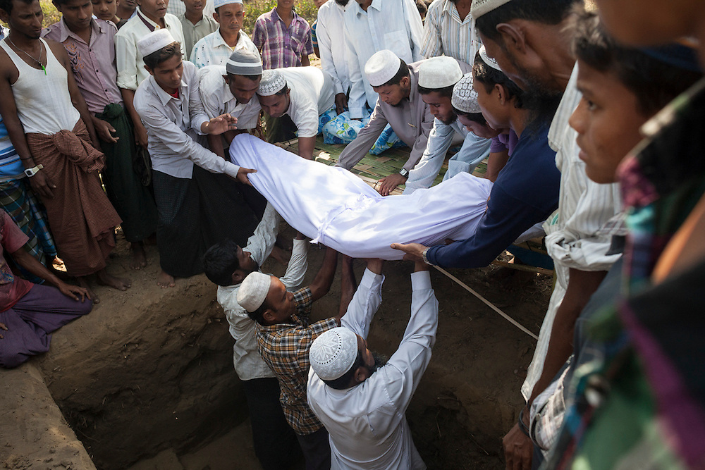 The body of Kalu Mohamad is buried during a funeral in an IDP camp for Rohingya Muslims in Sittwe, Myanmar.