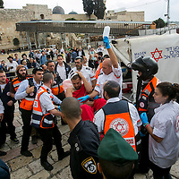 With the Western Wall, the holiest site where Jews can pray in the background, Israeli medics evacuate a wounded man following a stabbing attack in Jerusalem's Old City, Wednesday, Oct. 7, 2015. A Palestinian woman stabbed the Israeli man who then shot and wounded her in the Old City <br />