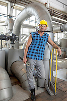 Full length portrait of young worker with wrench in industry