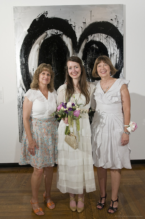 Photos from the wedding ceremony of Sarah Amelia Davis and Patrick Cory Smith, Saturday, June 11, 2011, at the Speed Art Museum in Louisville, Ky. (Photo by Brian Bohannon)