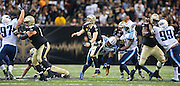 NEW ORLEANS, LA - NOVEMBER 8:  Drew Brees #9 of the New Orleans Saints throws a pass as he is hit by Derrick Morgan #91 of the Tennessee Titans at Mercedes-Benz Superdome on November 8, 2015 in New Orleans, Louisiana.  The Titans defeated the Saints in overtime 34-28.  (Photo by Wesley Hitt/Getty Images) *** Local Caption *** Drew Brees; Derrick Morgan