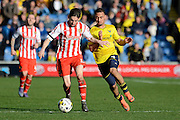 Oxford midfielder Kemar Roofe and Stevenage midfielder Tom Pett challenge for the ball during the Sky Bet League 2 match between Oxford United and Stevenage at the Kassam Stadium, Oxford, England on 25 March 2016. Photo by Alan Franklin.