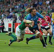 Ireland back row Peter O'Mahony tackling Italy's second row Josh Furno to prevent a certain try during the Rugby World Cup Pool D match between Ireland and Italy at the Queen Elizabeth II Olympic Park, London, United Kingdom on 4 October 2015. Photo by Matthew Redman.