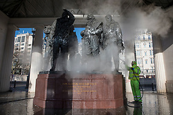 © Licensed to London News Pictures. 22/01/2019. London, UK. A workman cleans paint off the RAF Bomber Command Memorial in Green Pack after it was vandalised. Photo credit: Rob Pinney/LNP