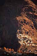 Morning light illuminates Karsha Monastery in the Zanskar Valley, Ladakh India.