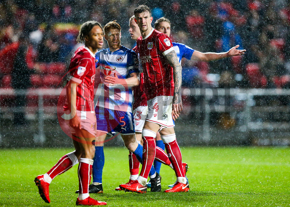 Aden Flint of Bristol City looks on ad Paul McShane of Reading challenges - Rogan/JMP - 26/12/2017 - Ashton Gate Stadium - Bristol, England - Bristol City v Reading - Sky Bet Championship.