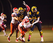 Milpitas defensive linemen Tevita Musika (56) and Jason Scrempos (88) block Saratoga outside lineman Jesse Chung (77) during the Homecoming game at Milpitas High School in Milpitas, California, on October 10, 2014. Milpitas beat Saratoga 49-0. (Stan Olszewski/SOSKIphoto)