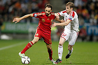 Spain's Juanfran Torres (l) and Belarus' Pavel Nekhaychik during 15th UEFA European Championship Qualifying Round match. November 15,2014.(ALTERPHOTOS/Acero)