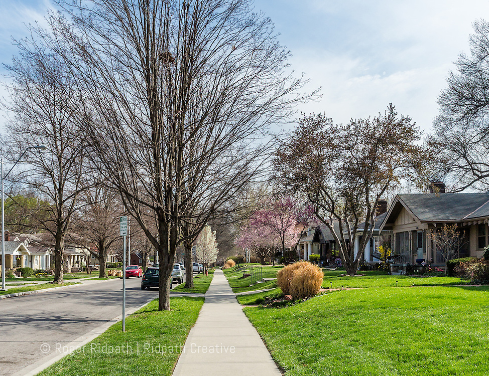 sidewalk and street Brookside neighborhood with spring color Kansas City Missouri