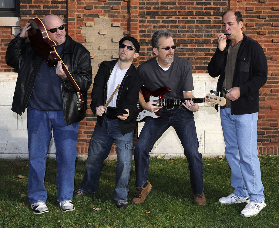 CHICAGO-NOVEMBER 05: Members of the band The Stingers pose for a publicity photo in Chicago, Illinois on November 5, 2011.  Members include (L to R) Dan Kening (guitar), Mark Malen (drums and vocals), Ron Vesely (bass) and Henry Small (keyboard, harp and vocals).