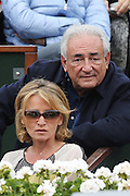 Paris, France. Roland Garros. June 9th 2013. Men's final.<br /> Dominique Strauss Kahn and Myriam L'Aouffir