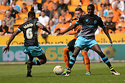 s18 holds off Wolverhampton Wanderers defender Matt Doherty during the Sky Bet Championship match between Wolverhampton Wanderers and Sheffield Wednesday at Molineux, Wolverhampton, England on 7 May 2016. Photo by Alan Franklin.