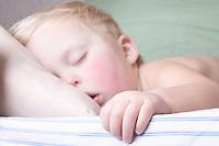 Baby boy lies sleeping
