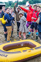 Worried about the amount of rain, so they brought a boat. The 2015 Glastonbury Festival, Worthy Farm, Glastonbury.