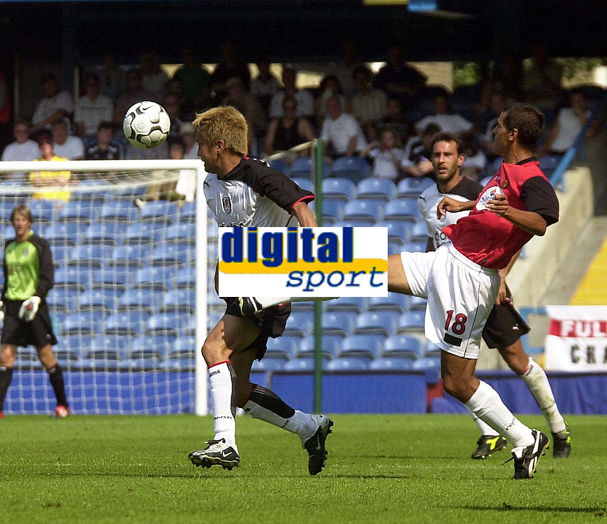 Photo. Glyn Thomas<br />Pre-Season Friendly.<br />Fulham v RCD Mallorca<br />Loftus Road, 10/08/2003<br />Fulham's Junichi Inamoto (L) holds off a challenge from Marcos.