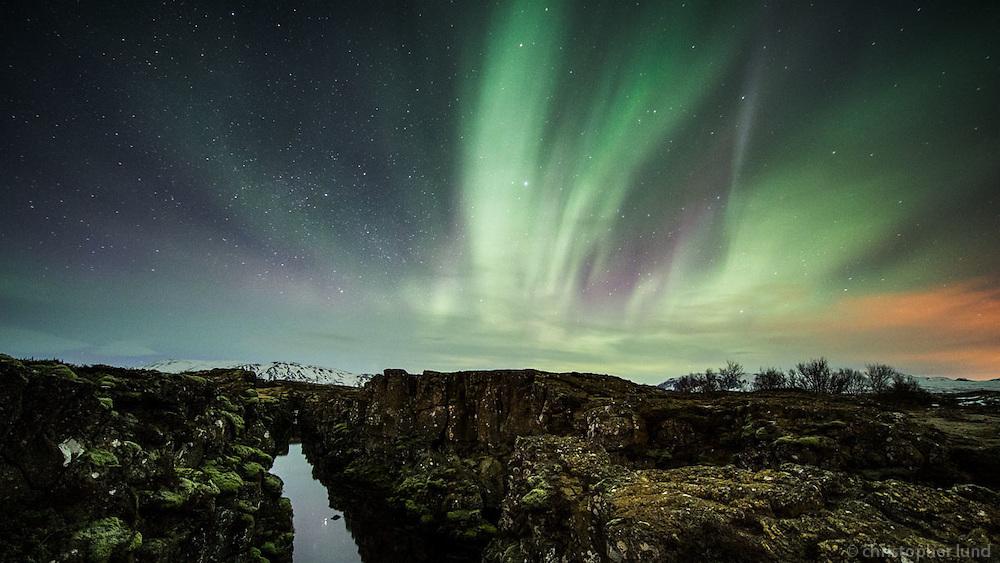 Northern Lights -Aurora Borealis over Flosagjá rift at Þingvellir National Park, South Iceland.