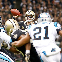 Dec 8, 2013; New Orleans, LA, USA; New Orleans Saints quarterback Drew Brees (9) passes against the Carolina Panthers during the first half of a game at Mercedes-Benz Superdome. Mandatory Credit: Derick E. Hingle-USA TODAY Sports