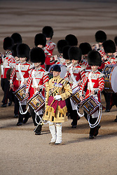 © Licensed to London News Pictures. LONDON, UK  09/06/11. A bandmaster leads drummers across Horse Guards Parade during the Annual Beating of the Retreat parade.  On two successive evenings each year in June a pageant of military music, precision drill and colour takes place on Horse Guards Parade in the heart of London when the Massed Bands of the Household Division carry out the Ceremony of Beating Retreat. 300 musicians, drummers and pipers perform this age-old ceremony. The Retreat has origins in the early days of chivalry when beating or sounding retreat pulled a halt to the days fighting. Please see special instructions. Photo credit should read Matt Cetti Roberts/LNP. Please see special instructions for usage rates. Photo credit should read Matt Cetti-Roberts/LNP