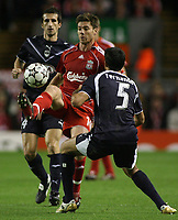 Photo: Paul Thomas.<br /> Liverpool v Bordeaux. UEFA Champions League, Group C. 31/10/2006.<br /> <br /> Xabi Alonso (Red) of Liverpool wins the ball before Fernando Menegazzo (5).