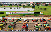 Hundreds of tractors fill the Fonner Park Race Track Saturday while preparing to set a record for the World's Largest Parade of Classic Tractors. 1,140 tractors participated in the attempt to break the previous record of 745 classic tractors in a parade set in Germany in 2008.