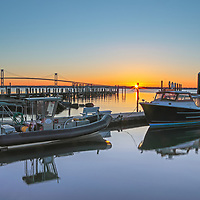 Rhode Island sunrise photographs of the Jamestown Newport ferry at Conanicut Marina in Jamestown, Rhode Island with the Claiborne Pell Bridge in the background are available for image licensing and as museum quality photography prints, canvas prints, acrylic prints, wood prints or metal prints. Wall art prints may be framed and matted to the individual liking and room decor needs:<br />